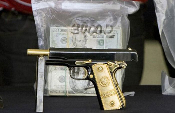 ead57c1b47_02-357-Magnum-semi-automatics-with-solid-gold-grips