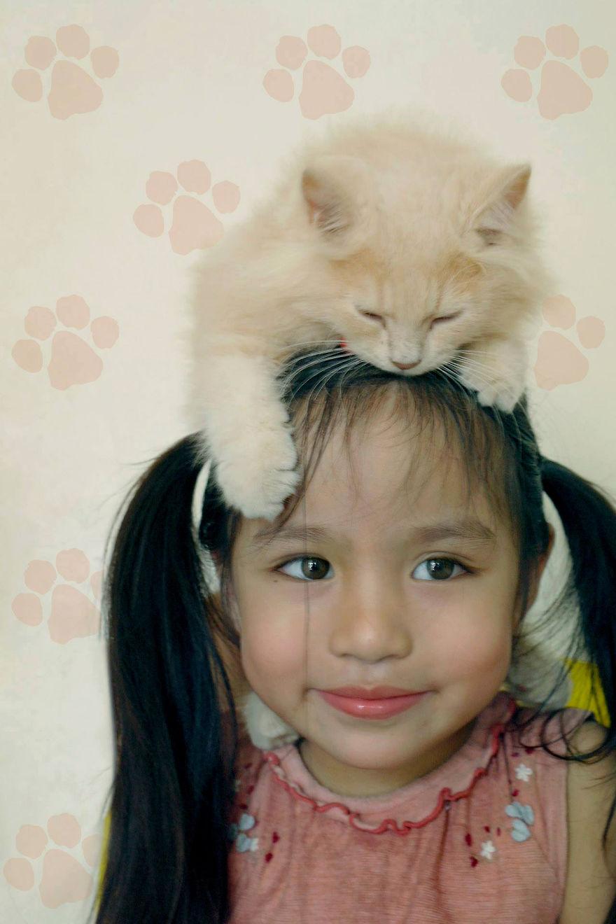 bambini-che-giocano-con-gatti-fotografia-05