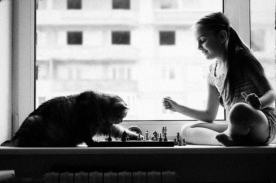 bambini-che-giocano-con-gatti-fotografia-36