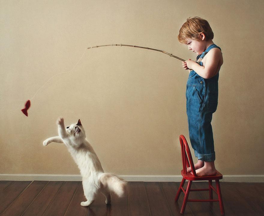bambini-che-giocano-con-gatti-fotografia-47