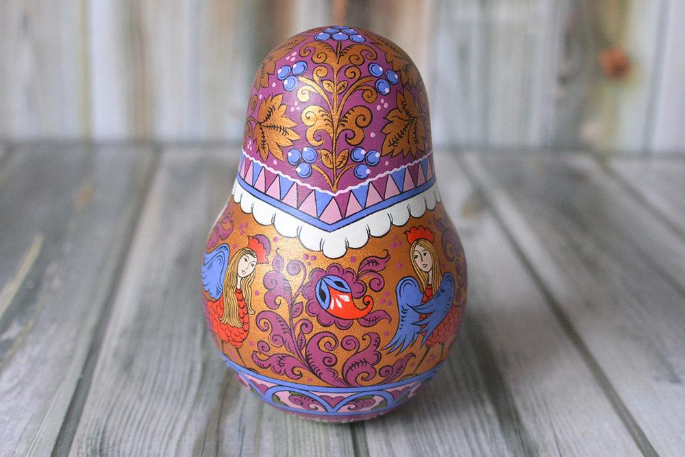 Matrioske e uova di pasqua dipinte a mano ed estremamente - Uova di pasqua decorati a mano ...