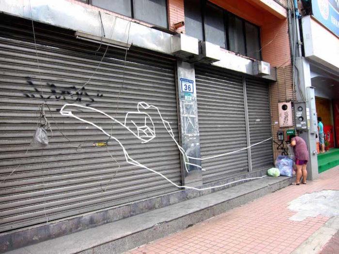opere-murales-graffiti-street-art-nastro-adesivo-buff-diss-02