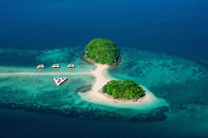 An Aerial View Of An Uninhabited Tropical Island