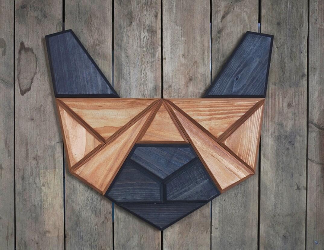Sculture geometriche pannelli decorativi legno teste animali