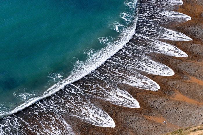 cuspidi-spiaggia-sabbia-disegni-onde-mare-1