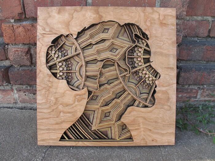 Conosciuto Intricate silhouette in rilievo su legno inciso al laser di  PQ36