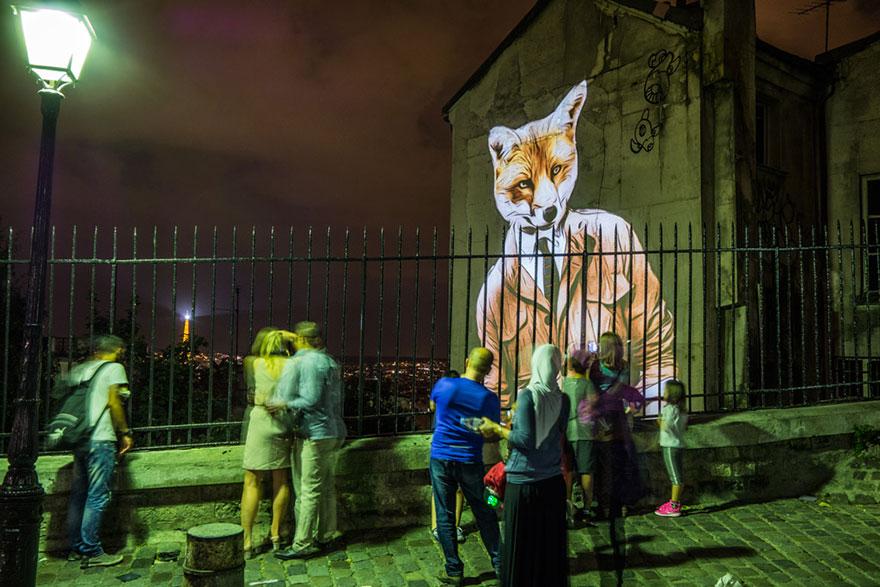 street-art-video-proiezioni-palazzi-parigi-animali-julien-nonnon-10