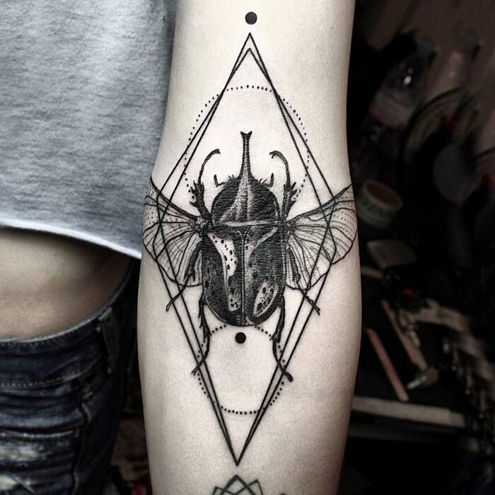 tatuaggi-animali-geometrici-eleganti-lineari-okan-uckun-03