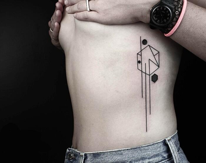 tatuaggi-animali-geometrici-eleganti-lineari-okan-uckun-13