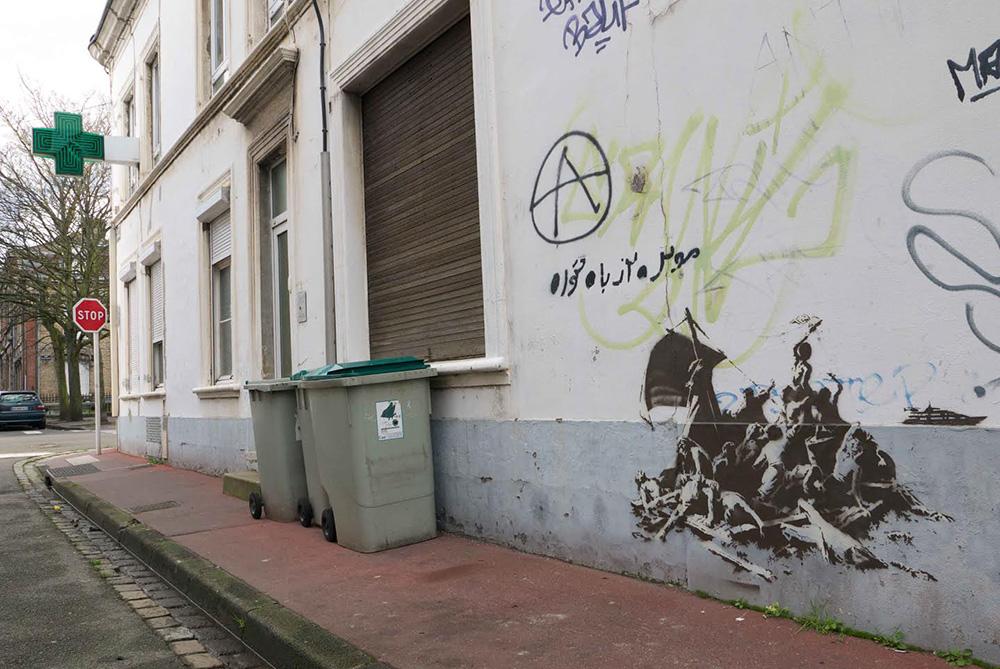 banksy-street-art-profughi-siriani-steve-jobs-4
