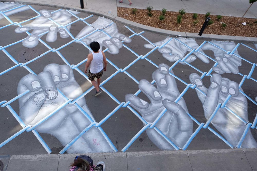 street-art-piste-ciclabili-montreal-roadsworth-01