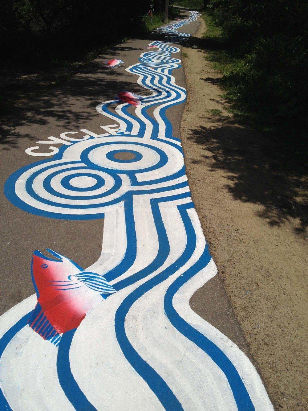 street-art-piste-ciclabili-montreal-roadsworth-15
