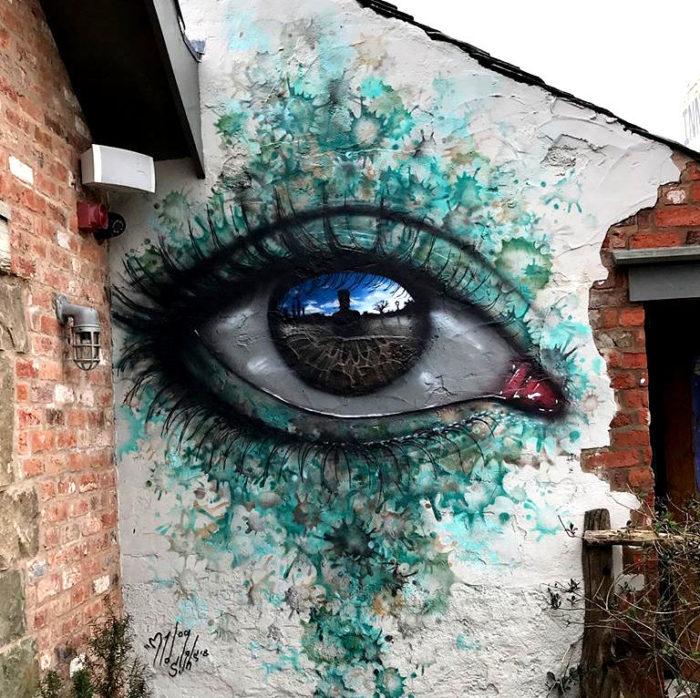 Occhi che riflettono il mondo nella street art di My Dog Sighs