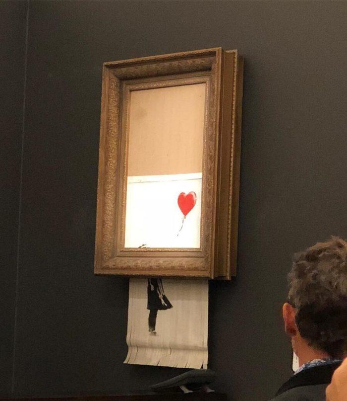 Banksy, l'opera da 1,4 milioni si autodistrugge dopo essere stata venduta all'asta