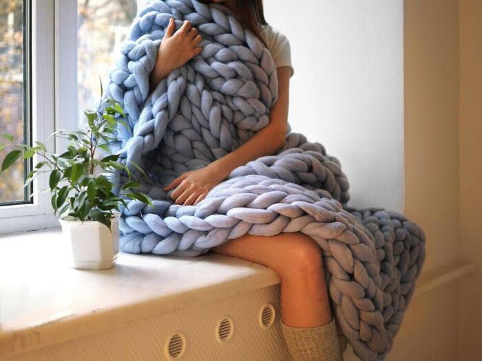 Creazioni in pura lana merino gigante, il design essenziale, elegante e sobrio.