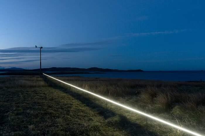 Installazione di luci mostra l'alzamento del livello del mare causato dal riscaldamento globale