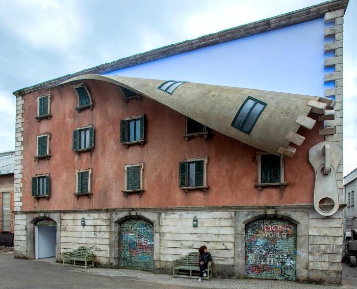 Illusioni ottiche e Street Art a Milano: un edificio che si apre con una zip