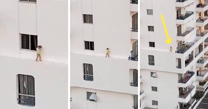 Passeggiata pericolosa di una bambina su un cornicione al 5° piano di un hotel