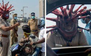 Poliziotto indiano indossa casco a forma di coronavirus per convincere la gente a tornare a casa