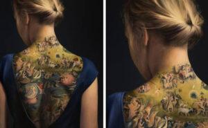 """Ragazza tatuata con il """"Giardino delle Delizie"""". Ma non è una foto, bensì un dipinto su tela"""