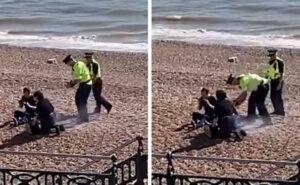 Stanchi di stare a casa fanno un barbecue sulla spiaggia, poliziotto riempe casco d'acqua e la versa sopra